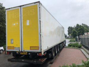 white trailer with yellow doors