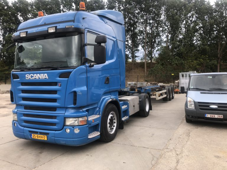 Blue scania tractor head with container chassis